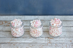 Three glass jars filled to brim marshmallow. Three glass jars filled to the brim marshmallow royalty free stock photo