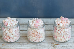 Three glass jars filled to brim marshmallow. Three glass jars filled to the brim marshmallow stock photography