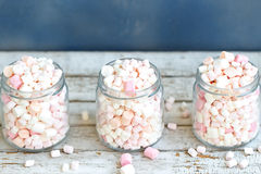 Three glass jars filled to brim marshmallow. Three glass jars filled to the brim marshmallow stock images