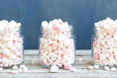 Three glass jars filled to brim marshmallow. Three glass jars filled to the brim marshmallow stock photos