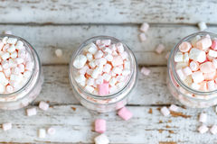 Three glass jars filled to brim marshmallow. Three glass jars filled to the brim marshmallow royalty free stock images