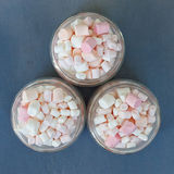 Three glass jars filled to brim marshmallow. Three glass jars filled to the brim marshmallow.The view from the top royalty free stock photo