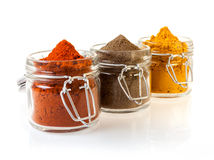 Three Glass Jars Filled With Spices Royalty Free Stock Images