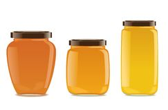 Three glass jars with jam or honey Stock Photo