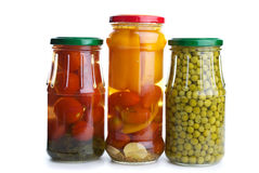 Three glass jars with marinated vegetables Royalty Free Stock Image