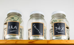 Three glass jars on wooden shelf for savings Stock Photo