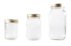 Three glass mason jars on an isolated background Stock Image