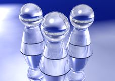 Three Glass Pawns Stock Images