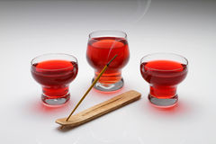 Three glass of Red tea. Three red tea glass on the table with fragrance stick Royalty Free Stock Image