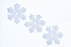 Three glass snowflakes Stock Photos