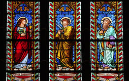 Three glass stained windows in church stock photo