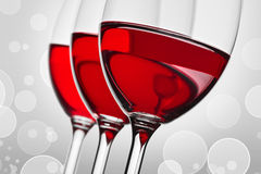 Three glass wih red wine stock images