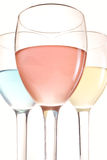 Three glasses. With red blue and yellow drinks Stock Images