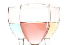 Three glasses. With red blue and yellow drinks Royalty Free Stock Image