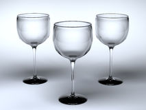 Three glasses. Three empty glasses on a white surface Royalty Free Stock Photo