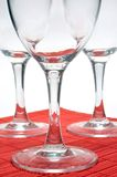 Three glasses. Of wine on a red mat Royalty Free Stock Photography