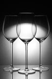 Three glasses. On glass plate Royalty Free Stock Images