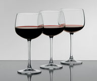 Three glasses. Three wine glasses on the glass Royalty Free Stock Photography