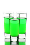Three glasses of absinthe. Over the white royalty free stock image