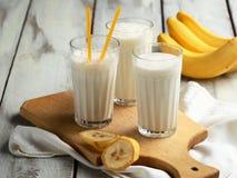 Three glasses of banana milkshake. Royalty Free Stock Image
