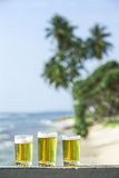 Three glasses of bear. On the porch near coast Royalty Free Stock Images