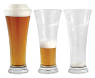 Three glasses of beer. Drinking stages, with one full, one half gone, and one empty isolated on a white background. Also symbolising optimism and pessimism stock images