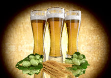 Three glasses of beer with barley and hops - 3D render Royalty Free Stock Image