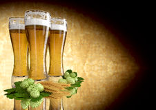 Three glasses of beer with barley and hops - 3D render Stock Image