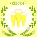 Three glasses of beer, barley stalks and branches of hops, Oktoberfest Royalty Free Stock Photography