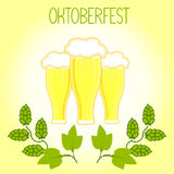 Three glasses of beer and hops branch, Oktoberfest Stock Images