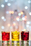 Three glasses with berry liqueur on the bar at a royalty free stock images