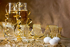 Three glasses of champagne and golden decoration w Royalty Free Stock Photo