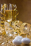 Three glasses of champagne and golden decoration w Royalty Free Stock Photography