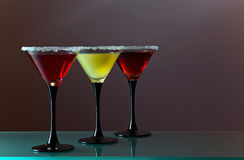 Three glasses with a cocktail Stock Photos