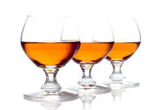 Three glasses of cognac isolated on white Royalty Free Stock Photography