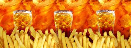 Three glasses with cola and french fries on colas Stock Photography