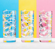 Three glasses on colorful background. Vintage style Stock Photo