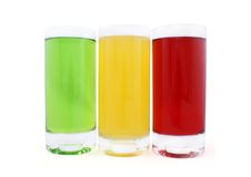Three glasses with coloured juice Royalty Free Stock Image