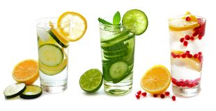 Three glasses of detox water with fruit isolated on white Stock Photo