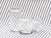 Three glasses of drinking water on striped tablecloth Stock Image