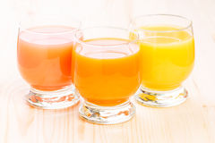 Three glasses of fresh natural juice. Royalty Free Stock Images