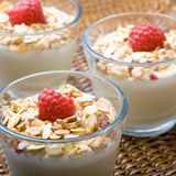 Three glasses of fresh yogurt and muesli Royalty Free Stock Photos