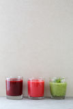 Three glasses with fruit smoothie on concrete background Stock Photography