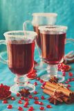 Three glasses of hot mulled wine with pomegranate seeds and spices Royalty Free Stock Image