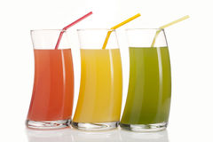 Three glasses of juice. Three glasses of red, green and yellow juice Royalty Free Stock Images
