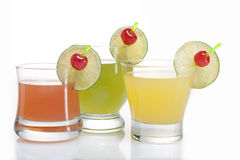 Three glasses of juice. Three glasses of red, green and yellow juice Royalty Free Stock Photos