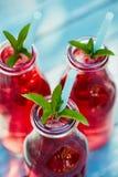 Three glasses of lemonade with raspberries Royalty Free Stock Images