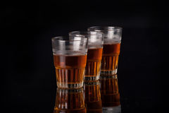 Three glasses of liquor Royalty Free Stock Images