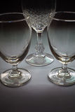 Three glasses low key Stock Images
