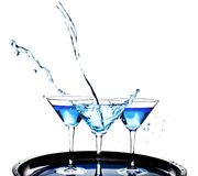 Three glasses of martini on white background royalty free stock images